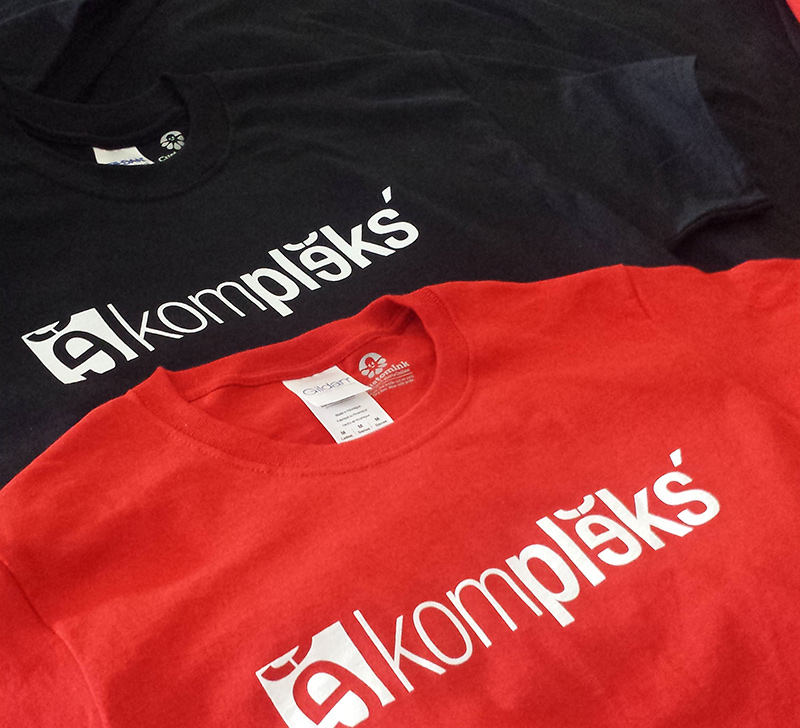 Kompleks Creative branded t-shirts in red and black, our primary colors.